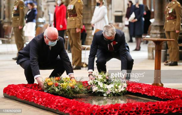 Australian High Commissioner George Brandis and New Zealand High Commissioner Bede Corry place floral wreaths by the British grave of the Unknown...