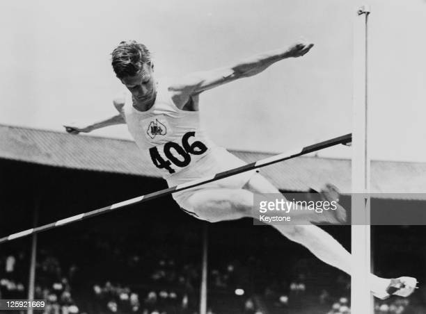 Australian high jumper John Winter clears the bar during an Olympic qualifying trial at Wembley Stadium London 30th July 1948 Later that day Winter...