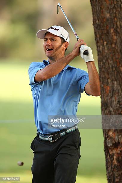 Australian hockey player Jamie Dwyer plays out of the rough on the 16th hole during the 2014 Perth International Pro-Am at Lake Karrinyup Country...