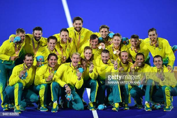 Australian hockey team players pose with their gold medals following the medal ceremony after defeating New Zealand in their men's field hockey gold...