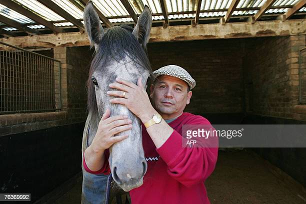 SLUG Australian horse trainer and exjockey Jim Lee holds his favourite horse Dash for Cash at his horse stables 'Hayai Lodge' in Sydney 28 August...
