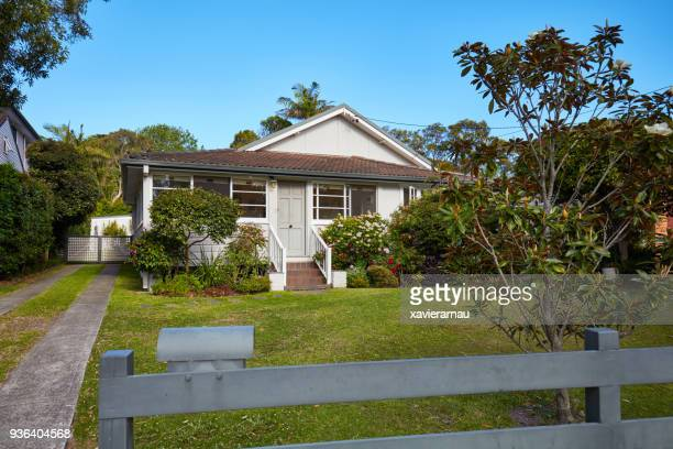 australian house from fence in suburbs against sky - small stock pictures, royalty-free photos & images
