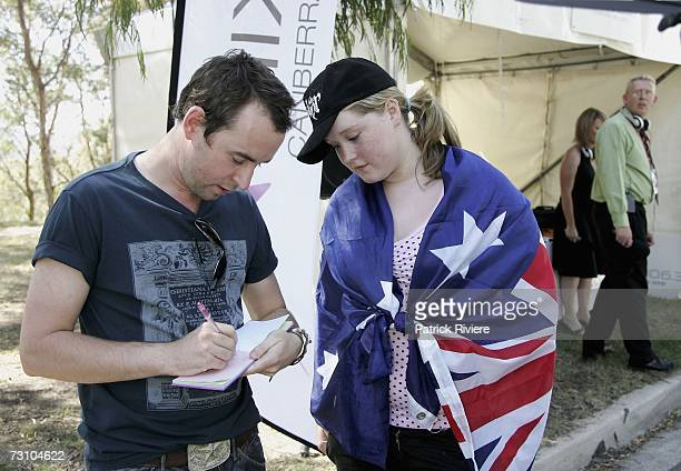 Australian Idol winner Damien Leith signs an autograph for a fan before been presented with his Australian citizenship during Canberra's Australia...