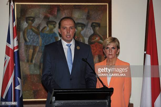 Australian Immigration Minister Peter Dutton and Australian Foreign Minister Julie Bishop address journalists during a press conference in Nusa Dua...