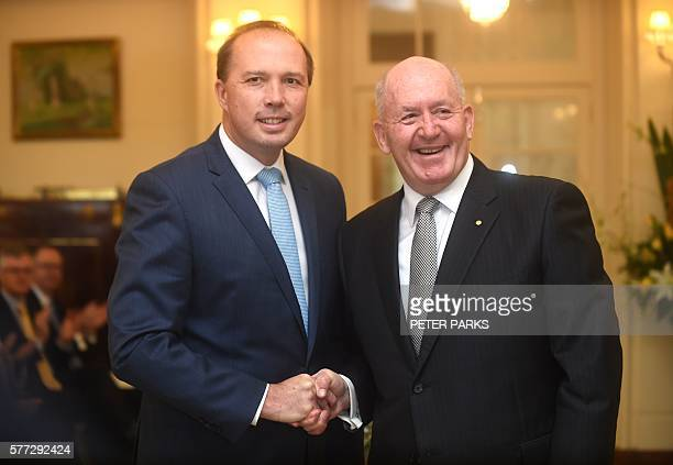 Australian Immigration Minister Peter Dutton shakes hands with the GovernorGeneral of Australia Peter John Cosgrove after his swearingin ceremony at...