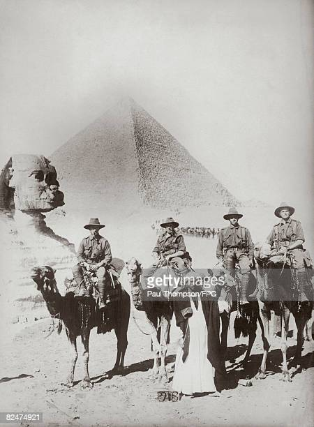 Australian infantrymen riding camels near the Sphinx with the Great Pyramid of Giza in the background circa 1915