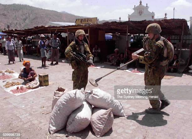 Australian INTERFET troops search the Dili market with a metal detector for dangerous items East Timor 26 October 1999 SMH Picture by ANDREW MEARES