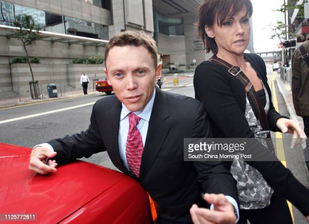 Australian jockey Chris Munce accompanied by an unidentified woman arrives at Wan Chai Ditrict Court in Hong Kong Munce was jailed for 30 months...
