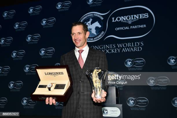 Australian jockey Hugh Bowman poses with trophy and watch after being awarded 2017 Longines World's Best Jockey Award during the Gala Dinner for the...