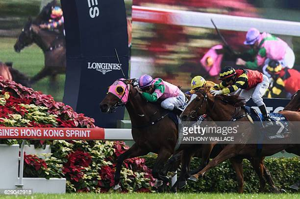 Australian jockey Zac Purton approaches the finish line before winning the 1200m Longines Hong Kong Sprint Group One race with Aerovelocity during...