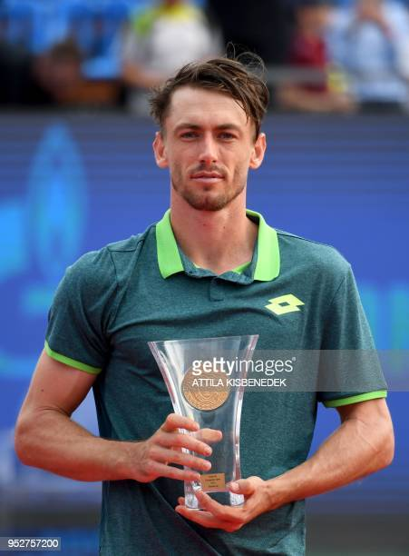 Australian John Millman poses with his trophy after he finished second at the Hungarian Open in Budapest on April 29 2018 following hist ATP final...