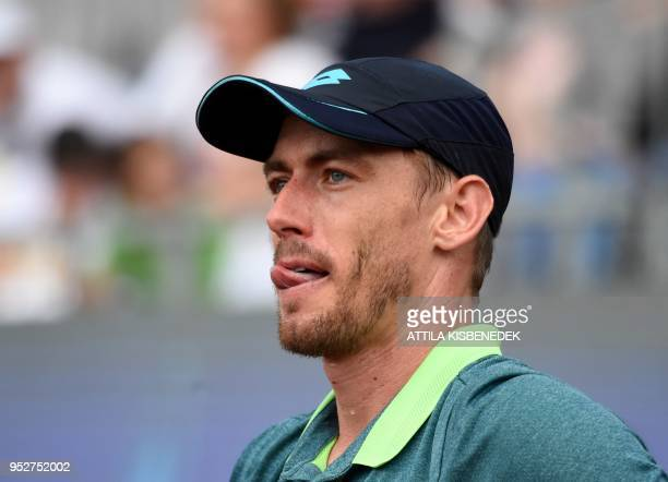 Australian John Millman reacts after a point against Italian Marco Cecchinato during their ATP final tennis match at the Hungarian Open in Budapest...