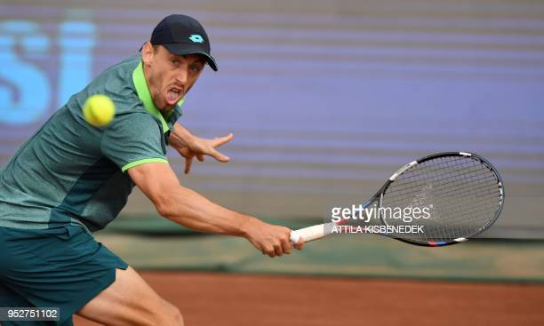 Australian John Millman returns the ball to Italian Marco Cecchinato during their ATP final tennis match at the Hungarian Open in Budapest on April...