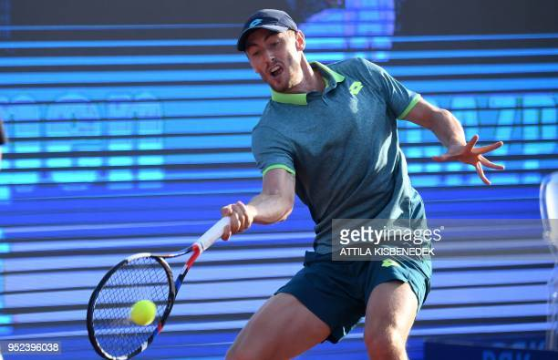 Australian John Millman returns the ball to Slovenian Aljaz Bedene during their ATP semifinal tennis match at the Hungarian Open in Budapest on April...