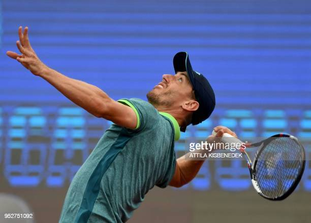 Australian John Millman serves to Italian Marco Cecchinato during their ATP final tennis match at the Hungarian Open in Budapest on April 29 2018