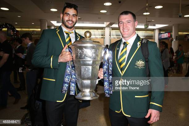 Australian Kanagroos players Greg Inglis and Paul Gallen pose with the Rugby League World Cup at Sydney Airport on December 4 2013 in Sydney...
