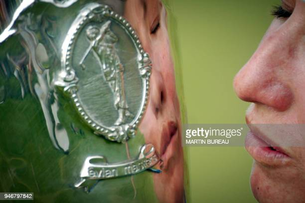 Australian Karrie Webb kisses her trophy 29 July 2006 in EvianLesBains central eastern France on the last of the four days of the Golf Evian Masters...