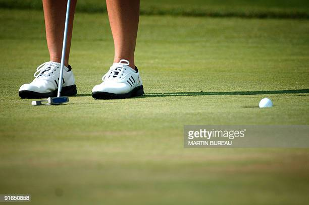 Australian Karrie Webb putts to the hole 27 July 2006 in EvianLesBains central eastern France on the second of the four days of the Golf Evian...