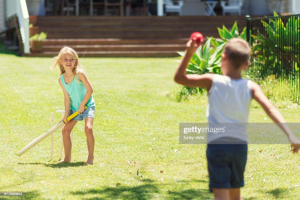 Australian kids playing cricket : Stock Photo