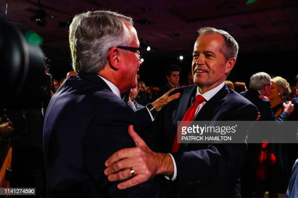 Australian Labor Party leader Bill Shorten greets former Labor Treasurer Wayne Swan following the election launch in Brisbane on May 5 2019 Shorten...
