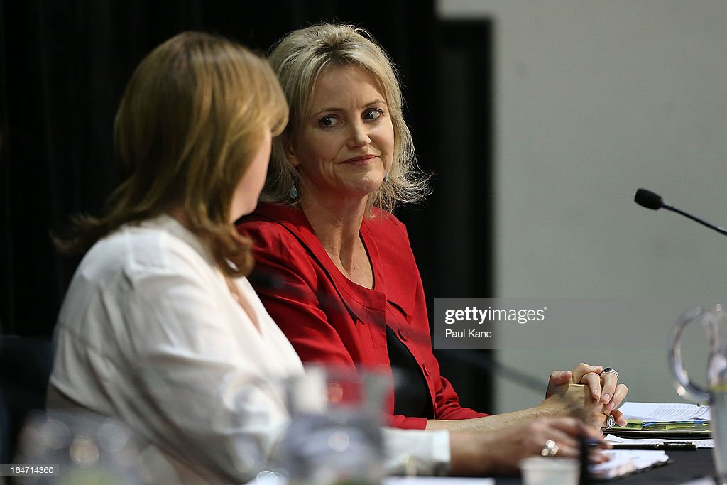 Australian Labour Cabinet Members Catherine King and Melissa Parke look on as Australian Prime Minister Julia Gillard answers questions from guests at Thornlie Senior High School on March 27, 2013 in Perth, Australia. Gillard held a community cabinet meeting with members of her new front bench in the suburb of Thornlie today, in her first visit to WA since the Labor party lost state elections.