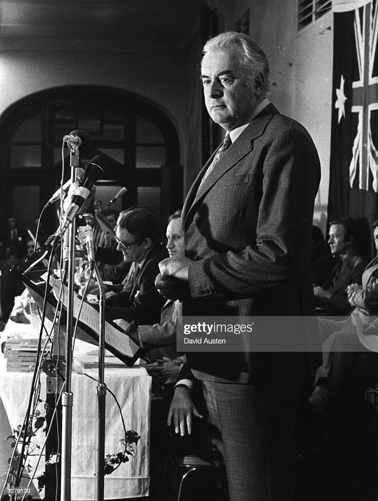 Australian Labour politician Gough Whitlam, at a conference with Malcolm Fraser (rear in glasses) of the Liberal party.