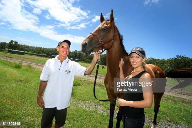 Australian lawyer Jennifer Robinson poses for a portrait with her father horse racing trainer Terry Robinson at his Berry property on January 20 2008...