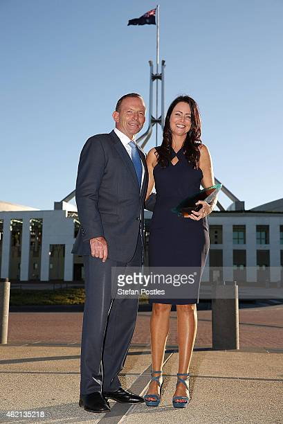 Australian Local Hero Juliette Wright poses with Prime Minister Tony Abbott during the 2015 Australian of the Year Awards at Parliament House on...