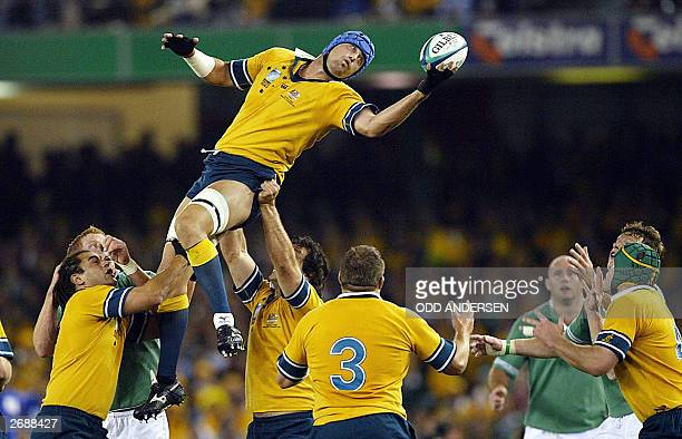 Australian lock Nathan Sharpe recieves a pass against Ireland during their Pool A game in the Rugby World Cup 2003 at the Telstra Dome in Melbourne...