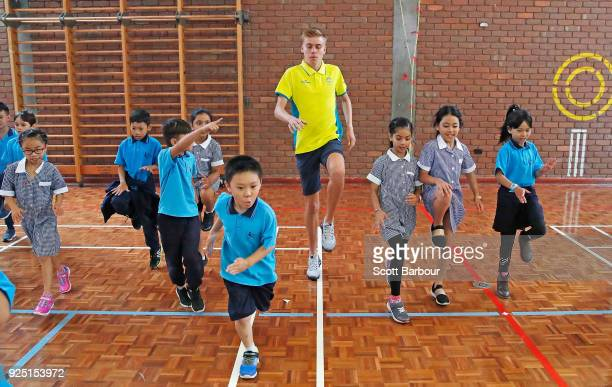 Australian longdistance runner Stewart McSweyn runs with school children as he visits them during the Commonwealth Games Keysborough Primary School...