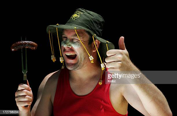 australian man at bbq - australia day stock pictures, royalty-free photos & images