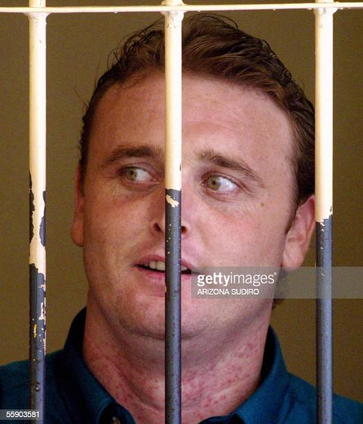 Australian Martin Stephens one of nine Australian drug suspects looks out of a cell at Denpasar District Court in Bali 12 October 2005 as he waits...