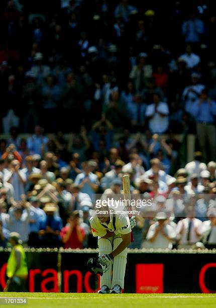 Australian Matthew Hayden bows to the crowd after making a century during the first day of the Boxing Day Fourth Ashes Test between Australia and...