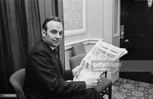 Australian media mogul Rupert Murdoch holding a copy of his News Of The World newspaper during a press conference in London 25th October 1968