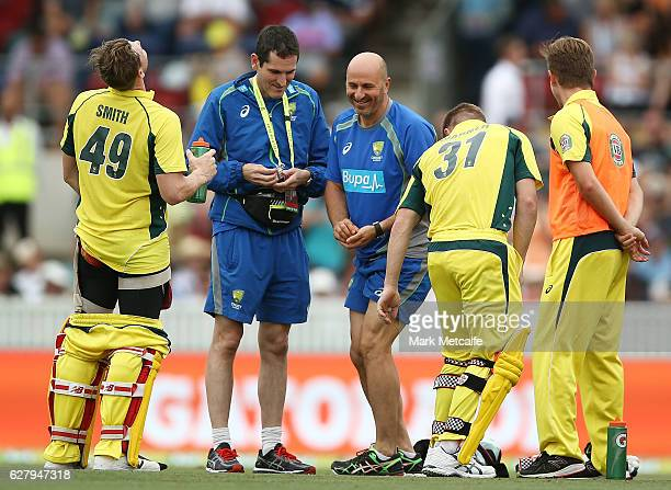 Australian medical support laugh as Steve Smith of Australia appears to be in pain after being hit in the body by a delivery during game two of the...