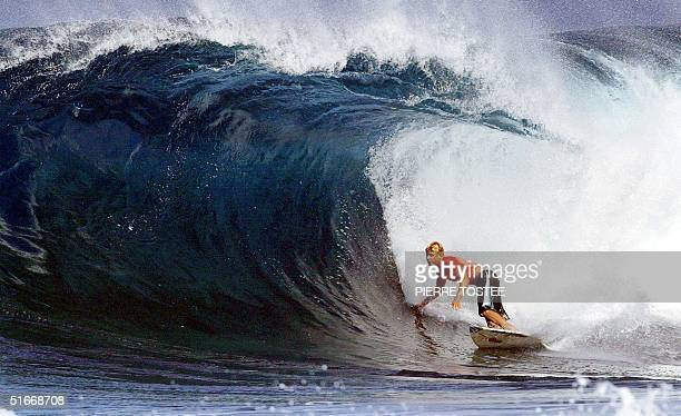 Australian Mick Fanning competes at the Banzai Pipeline on the North Shore of Oahu Hawaii during ther Xbox Pipeline Masters 17 December 2002 The Xbox...
