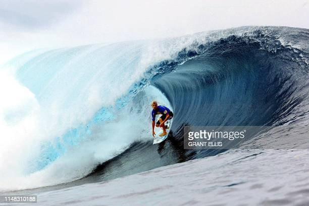 Australian Mick Fanning rides a wave to overcome compatriot Natahn Webster in round two of the Billabong Pro at Teahupoo in Tahiti 09 May 2002...