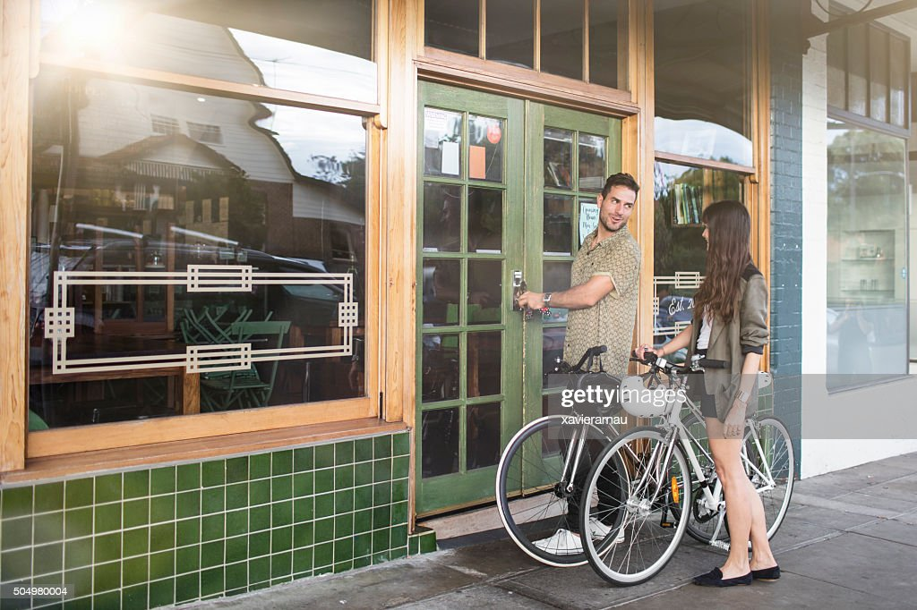 Australian mid adult couple locking their coffee shop business : Stock Photo