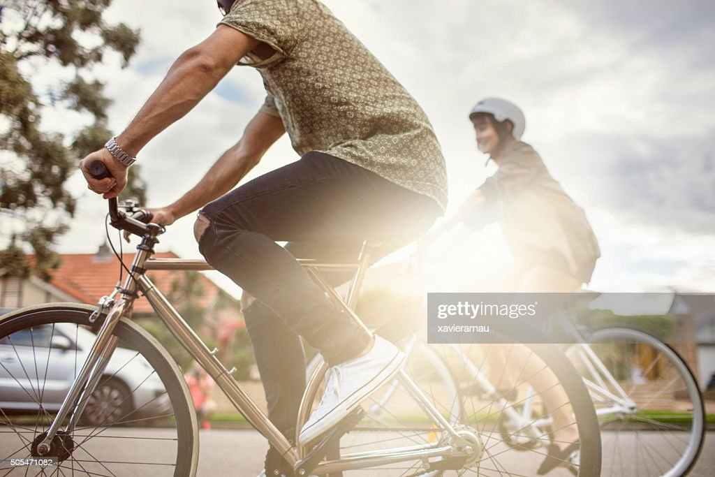 Australian mid adult couple riding bikes back home : Stock Photo