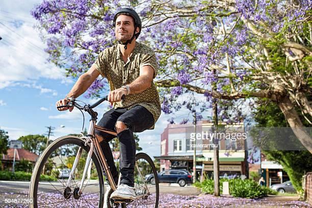 australian mid adult man riding the bike - bicycle stock pictures, royalty-free photos & images