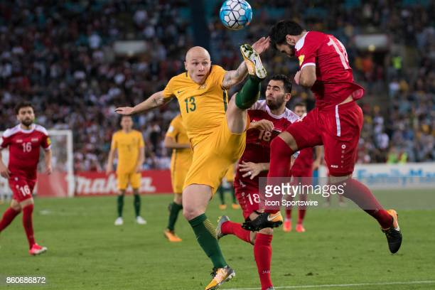Australian midfielder Aaron Mooy and Syrian midfielder Tamer Haj Mohamd go up for the ball at the Soccer World Cup Qualifier between Australia and...
