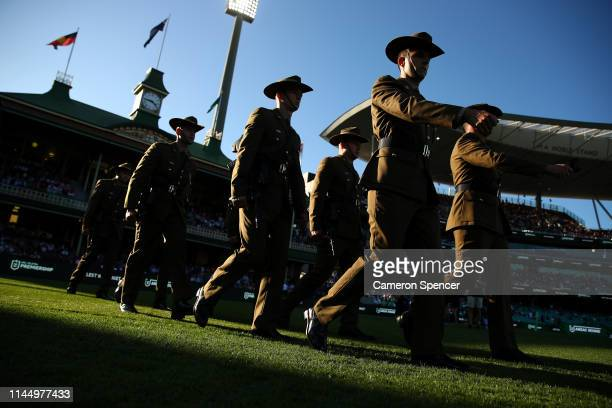 Australian Military personnel march during the round 7 NRL match between the Sydney Roosters and the St George Illawarra Dragons at the Sydney...