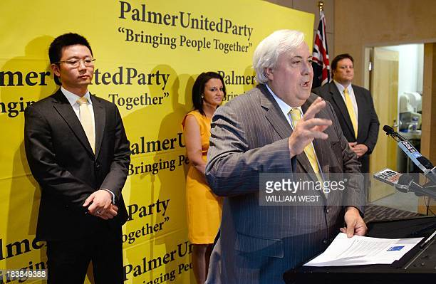 Australian mining billionaire and leader of the Palmer United Party Clive Palmer speaks as PUP senators Dio Wang Jacqui Lambie and Glenn Lazarus...
