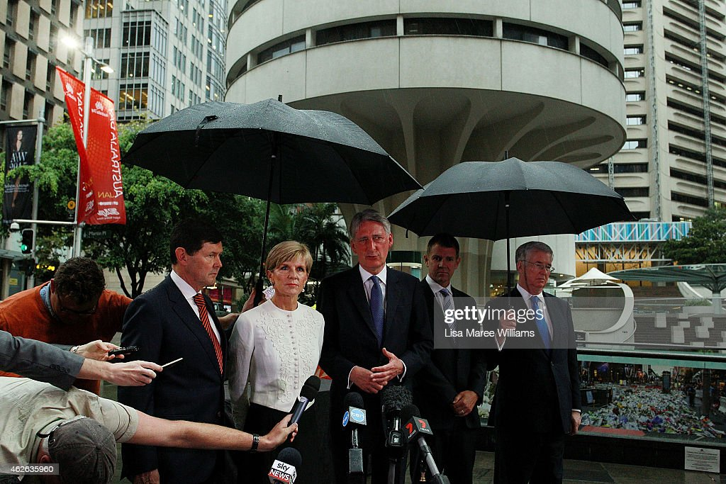 Australian Minister for Defence, Kevin Andrews, Australian Minister for Foreign Affairs, Julie Bishop, UK Secretary of State for Foreign and Commonwealth Affairs, Philip Hammond, NSW Premier Mike Baird, UK Secretary of State for Defence, Michael Fallon speak with the media following the signing of the Lindt Cafe Siege Condolence Book at Martin Place on February 2, 2015 in Sydney, Australia. On December 15 2014, gunman Man Haron Monis was shot dead by police after taking hostages at the Lindt Chocolat Cafe in Martin Place. Two other people died, 33-year-old cafe manager Tori Johnson and 38-year-old Sydney barrister Katrina Dawson.