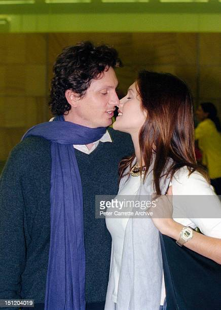 Australian model and actress Kate Fischer and boyfriend Gregory Alosio arrive at Sydney International Airport on January 13 2000 in Sydney Australia