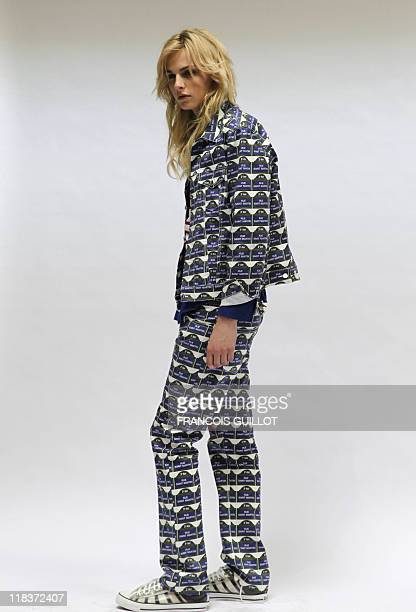 Australian model Andreja Pejic presents a creation by French designer JeanPaul Gaultier during the springsummer 2012 men's fashion collection show on...