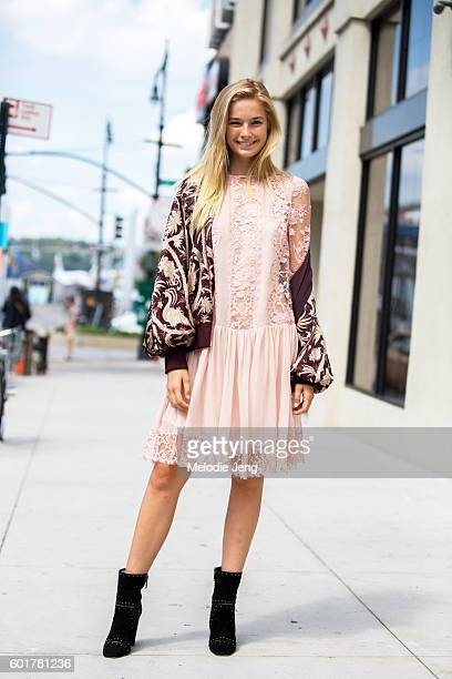 Australian model Bridget Malcolm wears a maroon embroidered jacket and pink lace dress at the Zimmermann show at Metropolitan West on September 9...