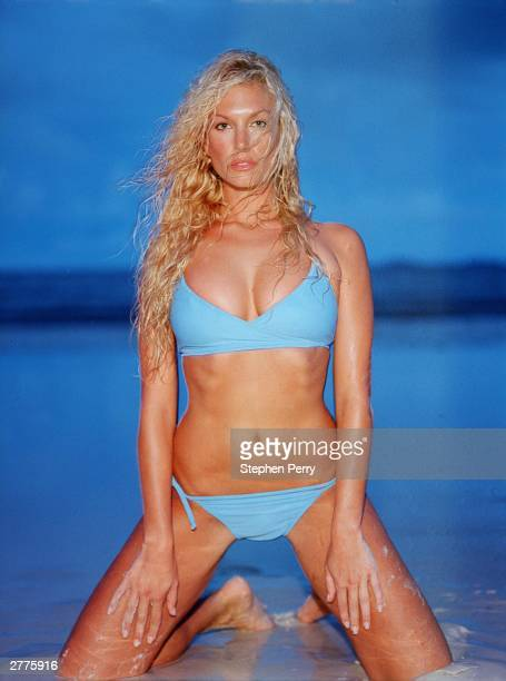 Australian model face of Playstation 2 TV personality Annalise Braakensiek poses during a photoshoot held in 2000 in England