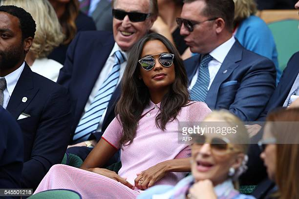 Australian model Frances Aaternir sits in the royal box on centre court during the men's semifinal match between Switzerland's Roger Federer and...