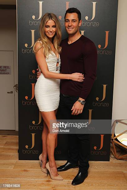 Australian model Jennifer Hawkins and husband Jake Wall pose at the launch of her new selftanning range at Bondi Beach on August 15 2013 in Sydney...